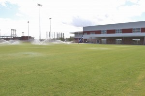 This grass area between the cages and training facility building is for agility work.