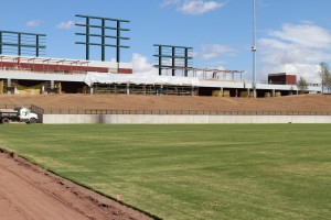Closer view of left field berm and scoreboard stanchions.