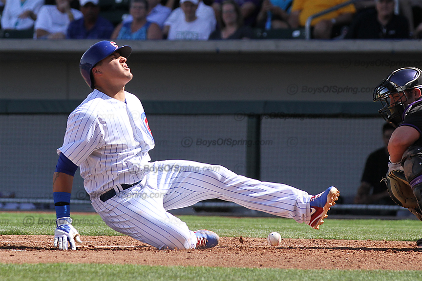 Cubs Javier Baez falls to ground after taking a foul ball off the foot