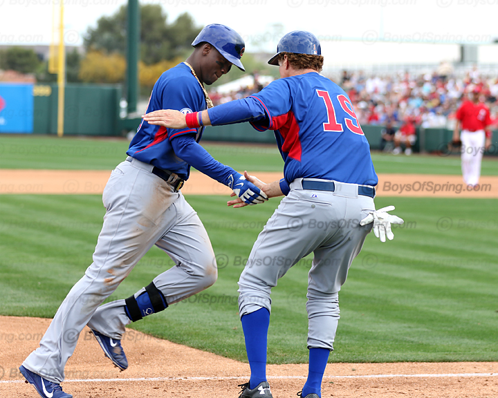 Third base coach Ferrell greets Soler on HR