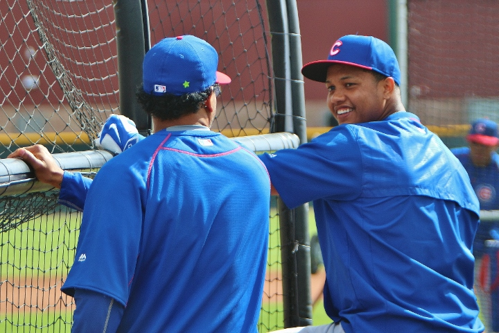 Manny Ramirez talks with Starlin Castro