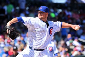 Jon Lester throwing against the Reds