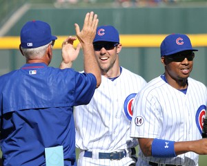 Matt Szczur high-fives Joe Maddon after first win