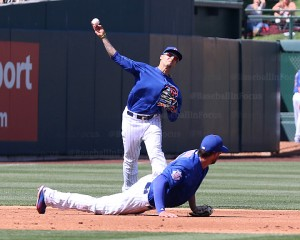 Javier Baez makes long throw over Kris Bryant to get runner at first