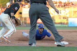 Kris Bryant slides into third with a triple on Thursday