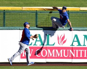 Javier Baez goes wall during bp