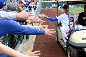 Cubs Kris Bryant riding fives