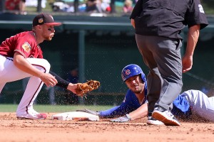 Kris Bryant under the tag on double