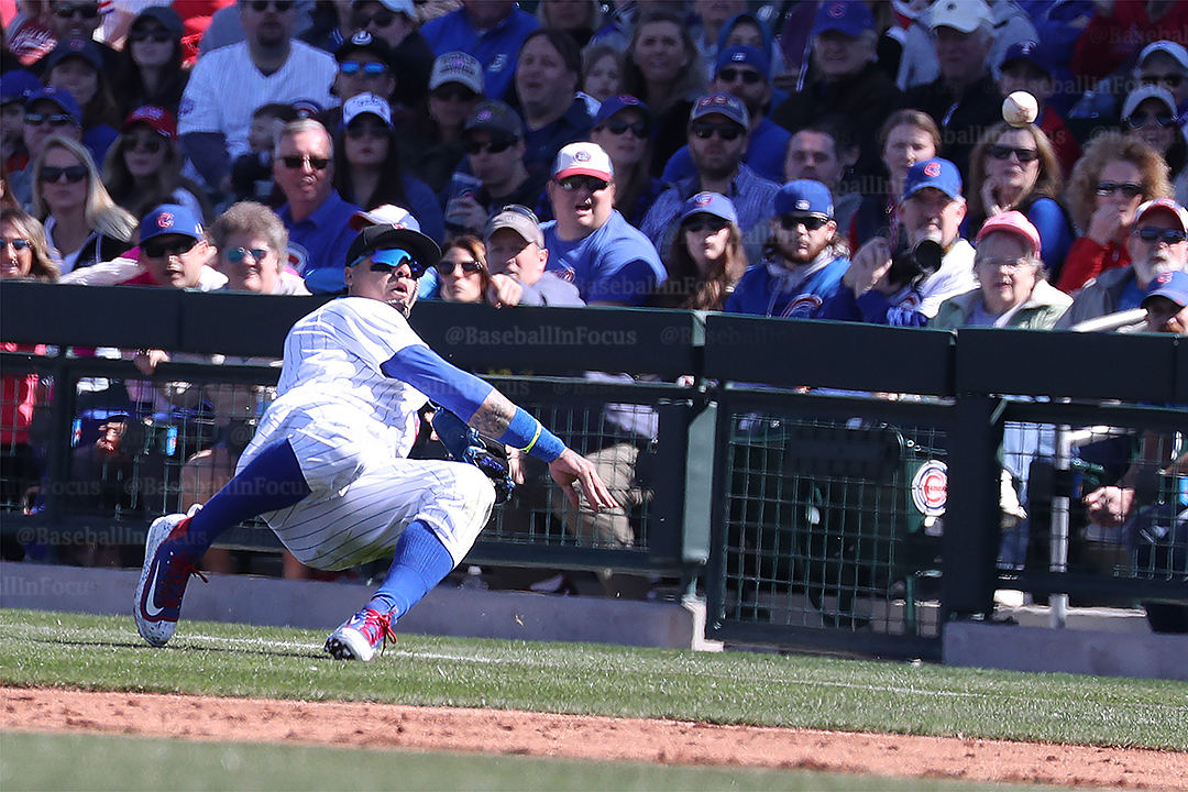 Baez throw from behind first base