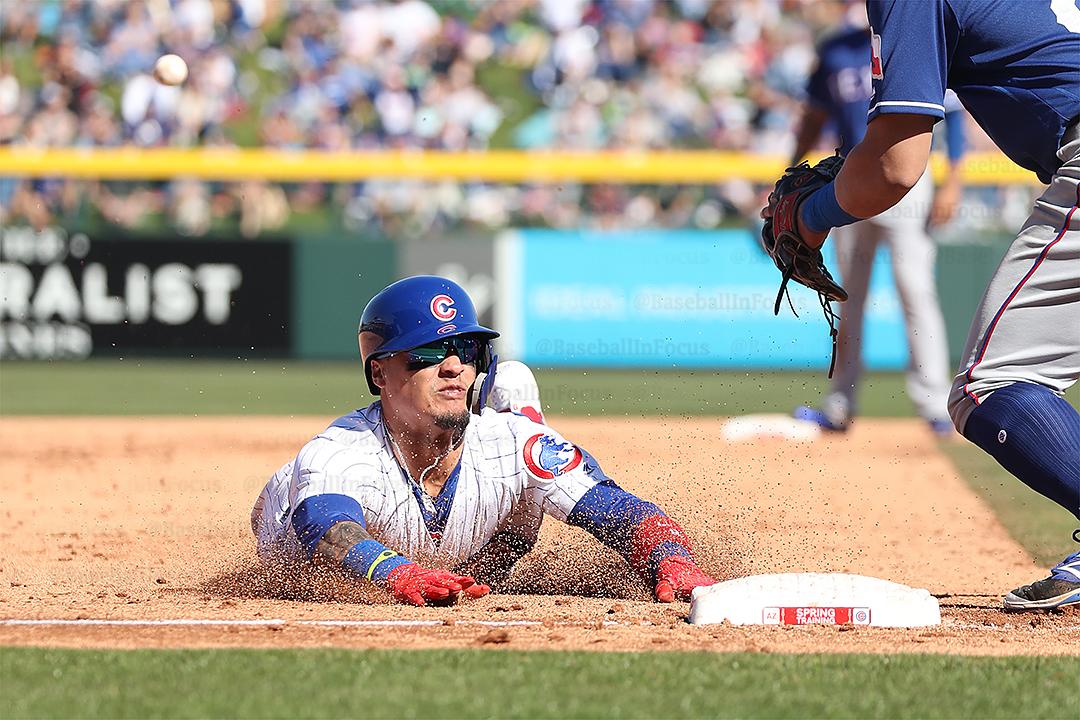 Baez slides safely into third base